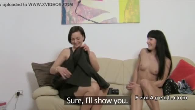 Female agent with strap on toy fucks babe